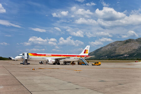 The aircraft of Spain Iberia airlines at Dubrovnik airport in Croatia prepared for boarding and flight.
