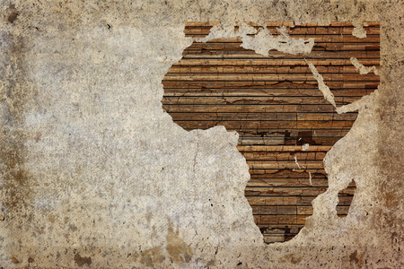 Grunge vintage wooden plank Africa map background. Banco de Imagens