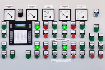 distribution board: Many buttons and switches - control panel in a machine. Stock Photo