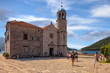 the church of our lady: Tourists in famous Church Our Lady of the Rocks in Kotor, Montenegro.