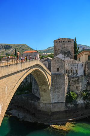 Tourists stroll across the Old Bridge in Mostar, Bosnia and Herzegovina.