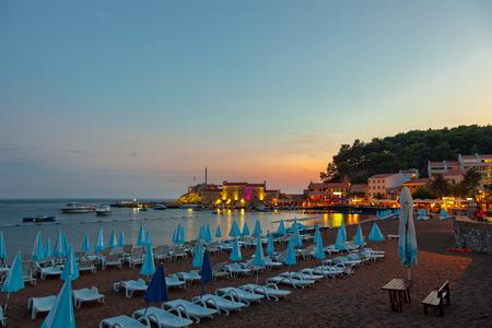 Beautiful night landscape of seaside town of Petrovac, Montenegro. photo