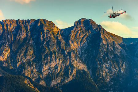 Helicopter in the Tatra Mountains - rescue mission. photo