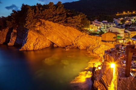 Night scene with cliff on the Adriatic sea coast in Petrovac, Montenegro. photo