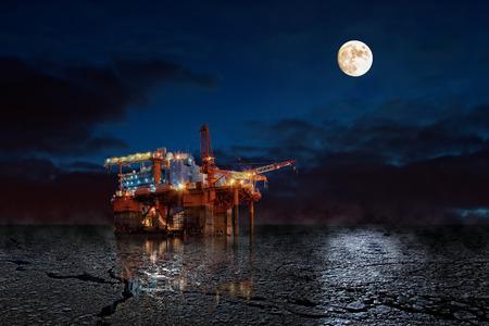 huile: Oil Rig la nuit dans un paysage d'hiver.