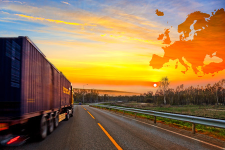 logistics world: Truck on road on Europe map background - shipping travel concept.