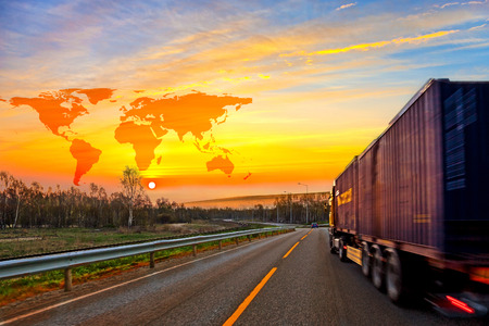 logistics world: Truck on road and World map background - shipping travel concept. Stock Photo