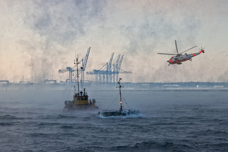 sinking: A helicopter rescue mission in difficult stormy weather. Stock Photo