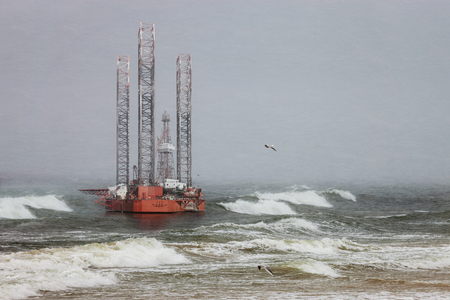 winter storm: Oil rig in a winter storm day during a violent blizzard. Stock Photo