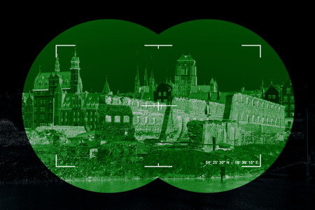 night vision: War damage ruins in Gdansk - view through the night vision device.