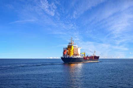water transport: Oil tanker ship at sea on a background of blue sky.