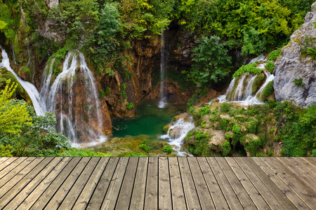 wooden deck: Waterfall in Plitvice lake and wooden plank, Croatia. Stock Photo