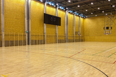 high school basketball: Image of a indoor basketball court at a school.