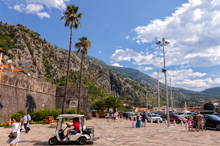 ramparts: Tourists walk along the promenade near to the ramparts of the Old Town, on July 18, 2014 in Kotor, Montenegro. Editorial