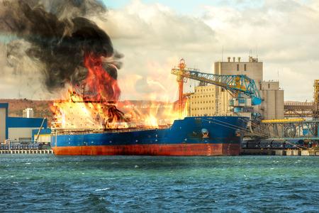 Burning cargo ship in the port.