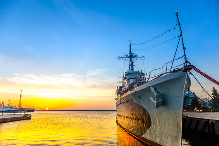 Warship at sunrise in the port of Gdynia, Poland. Stock Photo