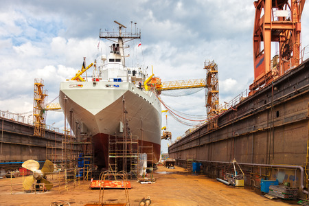 shipbuilding: Big ship rear view with propeller under repair. Stock Photo