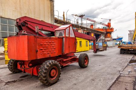 mobile crane: Industrial equipment mobile crane in shipyard basket. Stock Photo
