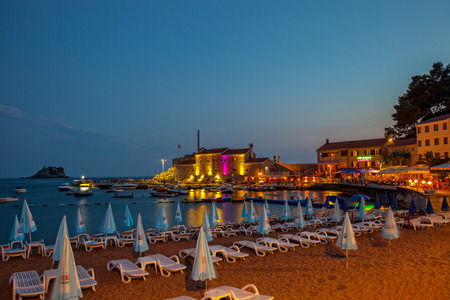 Tourists are relaxing at night on the pier, on July 17, 2014 in Petrovac, Montenegro.