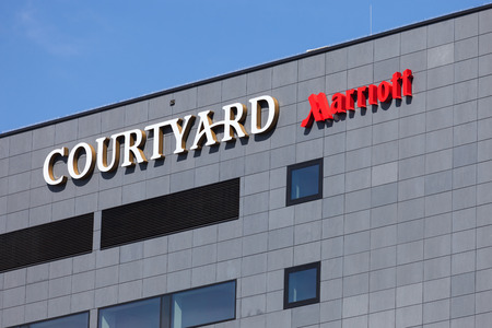 hotel chain: Close up of the logo of the hotel chain Marriott in Gdynia over blue sky on April 22 2015 in Gdynia Poland.