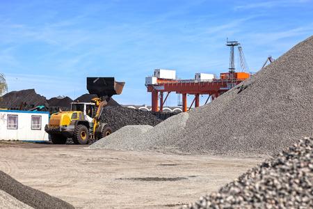 deposit: Coal and piles of stones yard storage.