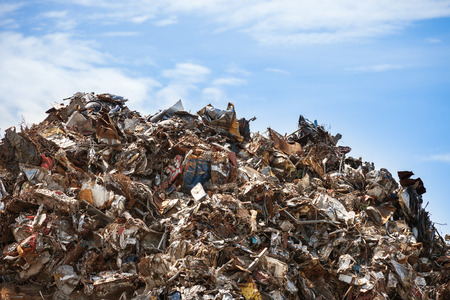 Scrap metal ready for recycling over blue sky. Stock Photo