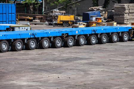 heavy weight: Heavy load transportation trailer with many platform. Stock Photo