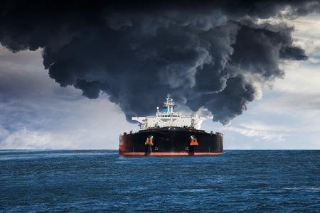 tanker: Burning Tanker ship on the sea. Stock Photo
