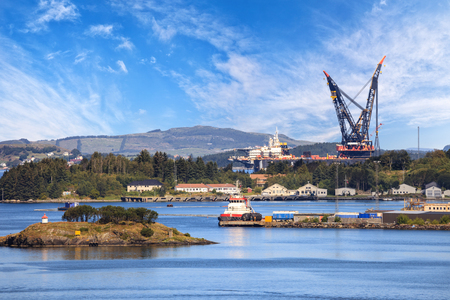 norwegian: Port wharf in a typical Norwegian scenery. Stock Photo