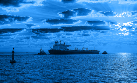 tanker ship: Tanker ship with tug boat on sea - Shipping concept. Stock Photo