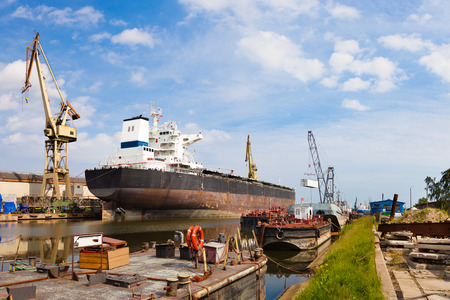 shipyard: Ship moored at the quay in shipyard of Gdansk, Poland.
