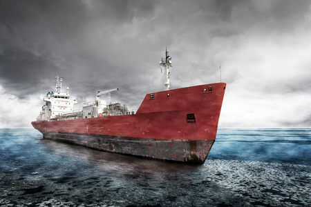 Cargo Ship on the sea with dramatic sky during in winter.