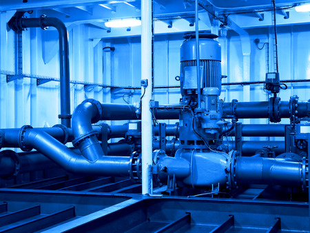 engine room: Industrial electric water pump and pipes - industry concept.