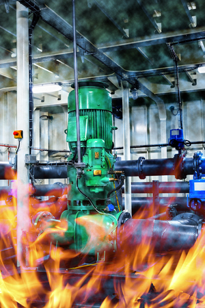 Pump on fire in a smoky industrial area. Stock Photo