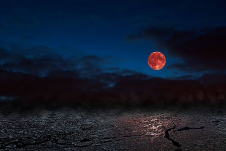 penumbra: Red full moon in red color also called Bloodmoon on the background frozen sea. Stock Photo
