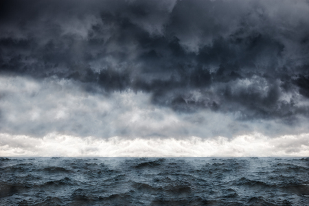 Dark clouds in the winter sky during a storm at sea.