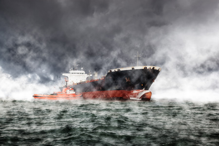 storms: Cargo ship at sea during a storm.