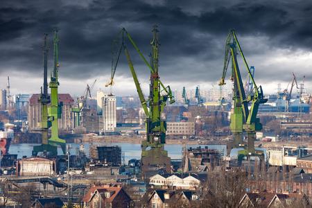 cranes: Big green cranes in shipyard of Gdansk, Poland. Stock Photo