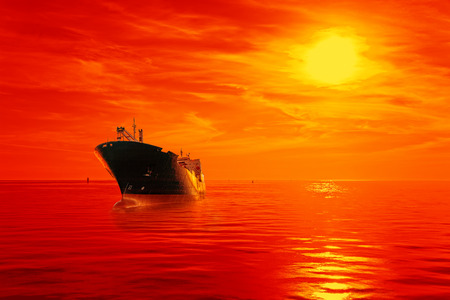 tanker ship: Silhouette of the tanker ship on red sunrise. Stock Photo