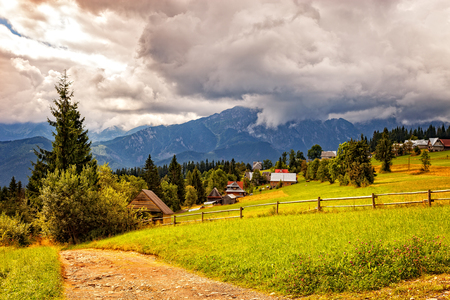 giewont: View on the High Tatra Mountains with dark clouds at background.