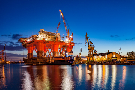 ship: Oil Rig in the shipyard for maintenance at night.