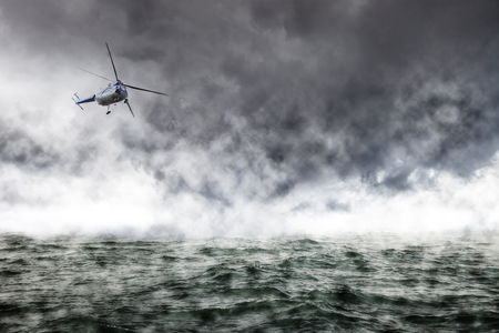 difficult mission: A helicopter rescue mission in difficult stormy weather at sea.