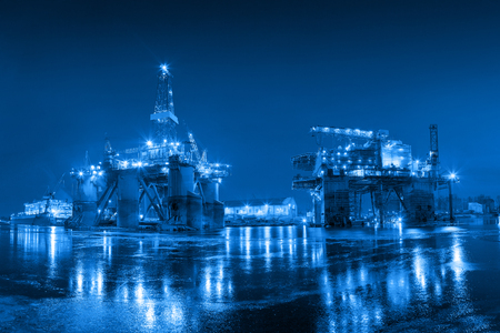 Oil Rig at night in Shipyard - industry concept.