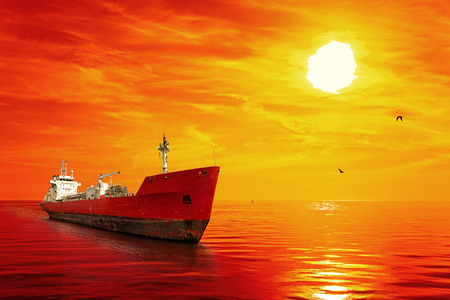 ship: Silhouette of the tanker ship on red sunrise. Stock Photo