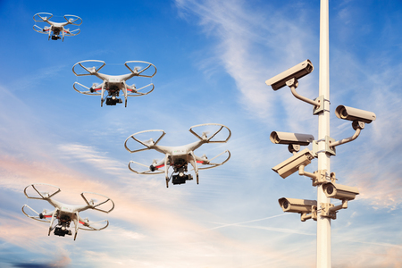 drones: Many drones flying against the blue sky.