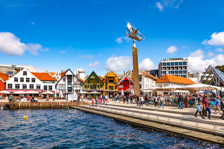 apartment tower old town: Lot of Tourists walking, shopping and sightseeing at Old Town, on July 15, 2015 in Stavanger, Norway.