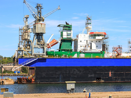 slipway: A big ship on the dry dock in a shipyard Gdynia, Poland. Stock Photo