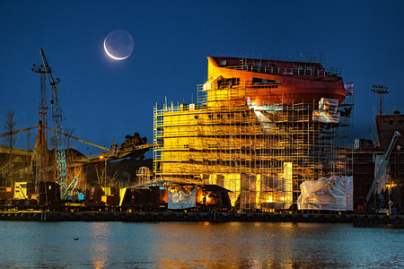 shipper: Ship under construction at night in Gdansk, Poland.