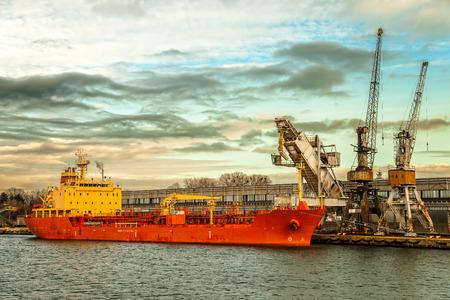 gravel: Ship under loading stone in Port of Gdansk, Poland.