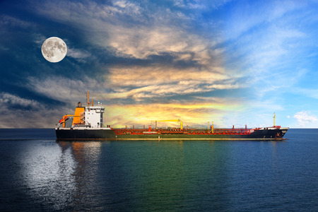 day night: Transition from night to day - shipping concept. Stock Photo